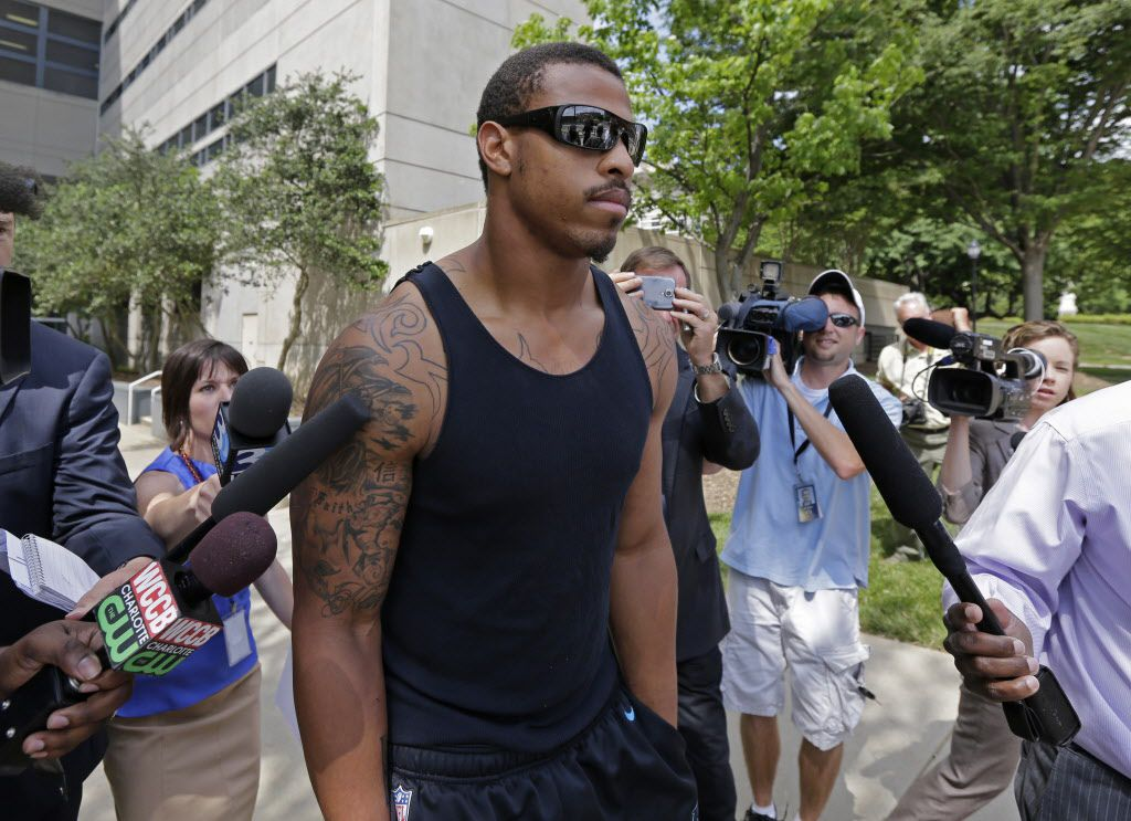 Greg Hardy leaves a Charlotte, N.C., jail last year after he was charged with beating up his girlfriend. (AP Photo)