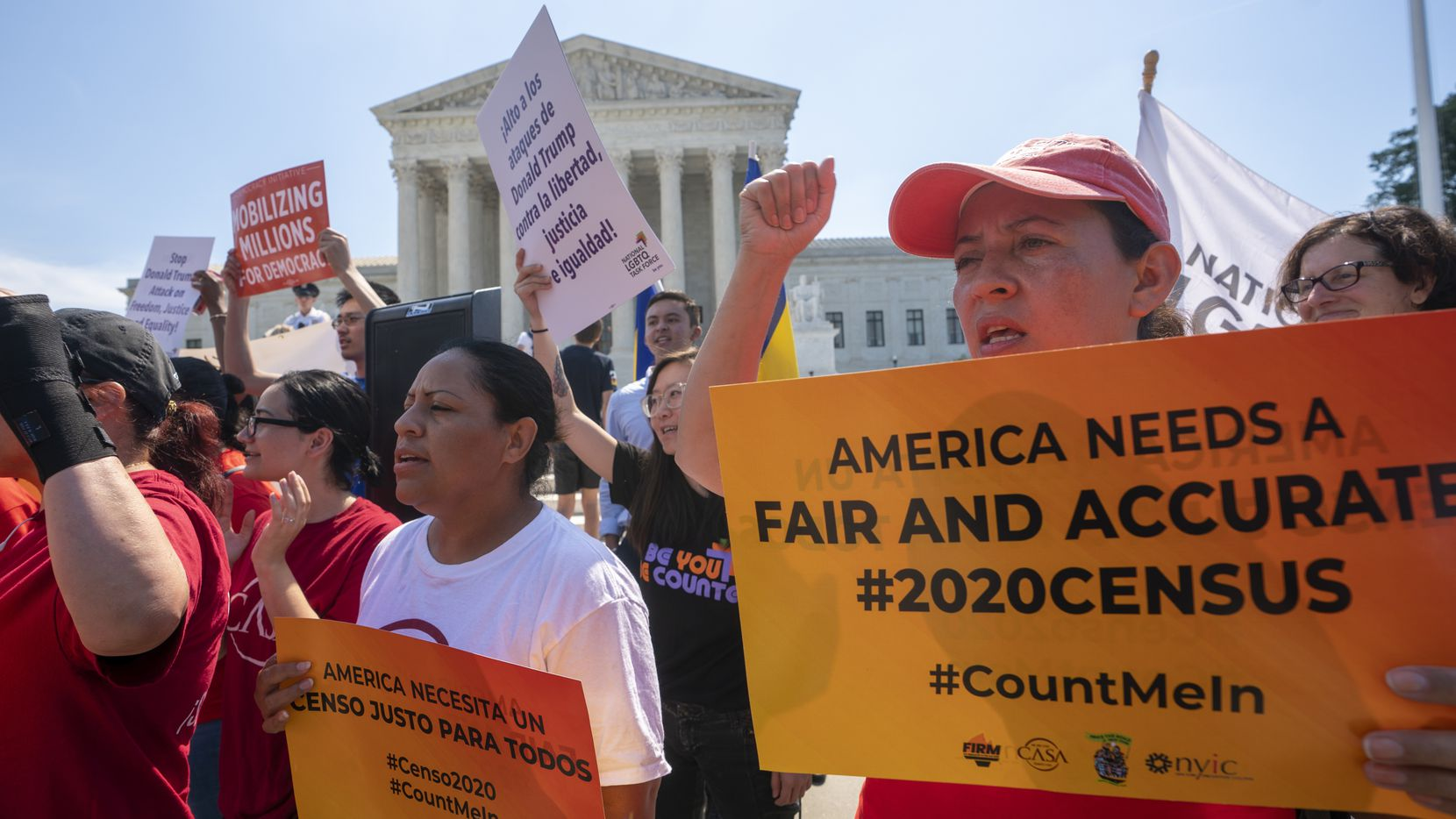 In this June 27, 2019, file photo, demonstrators gather at the Supreme Court on Capitol Hill in Washington. A prominent Latino organization said Monday, Feb. 10, 2020, the U.S. Census Bureau needs to explicitly communicate there will be no citizenship question ahead of the 2020 count, or risk undercounting minority groups.