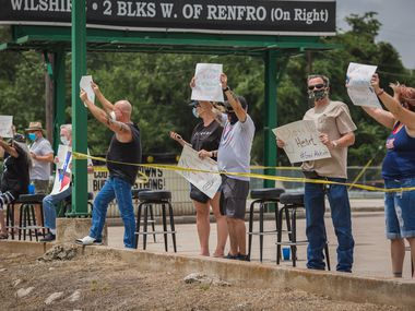 "The owner of Cooter Brown's in Burleson hosted a protest Sunday, June 28, 2020 to send a message that Gov. Greg Abbott's shutdown of bars is hurting her small business. ""The message I want to send is I'm important, too,"" says bar owner Tara Worley. ""Feeding my children is important, and this is how I do it."""