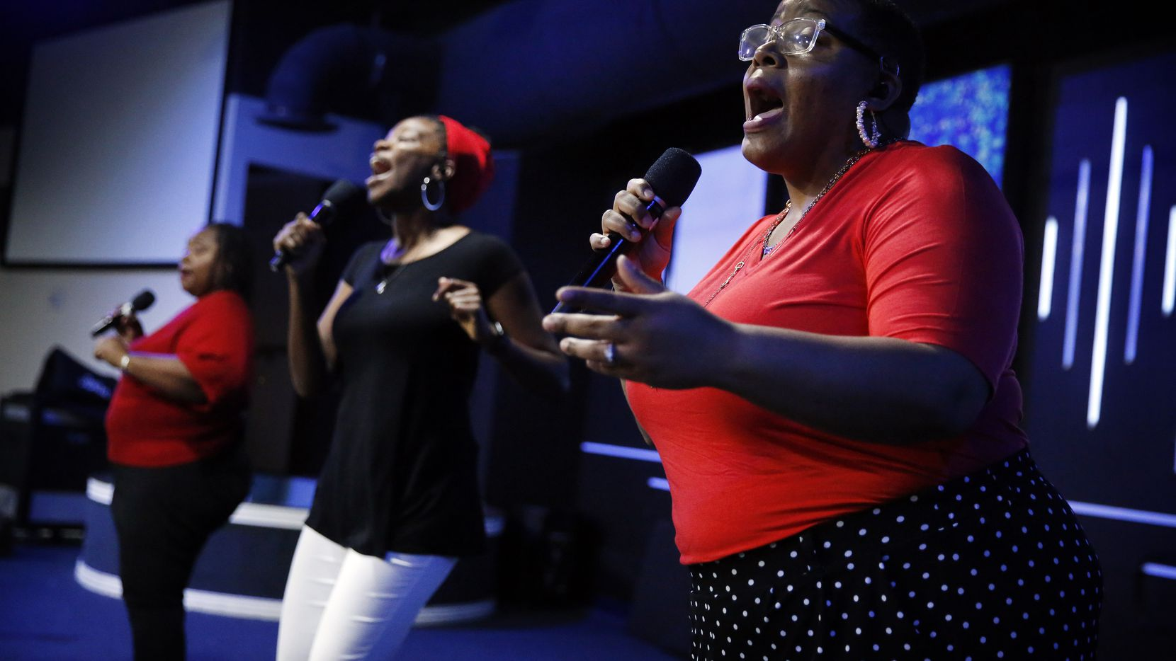 Chameka Barras (right) sings alongside two other members of the praise team, Monisha Randolph (center) and Candice Bryant, during a rehearsal at Cornerstone Baptist Church in Dallas. The church services are being held online during the COVID-19 pandemic.