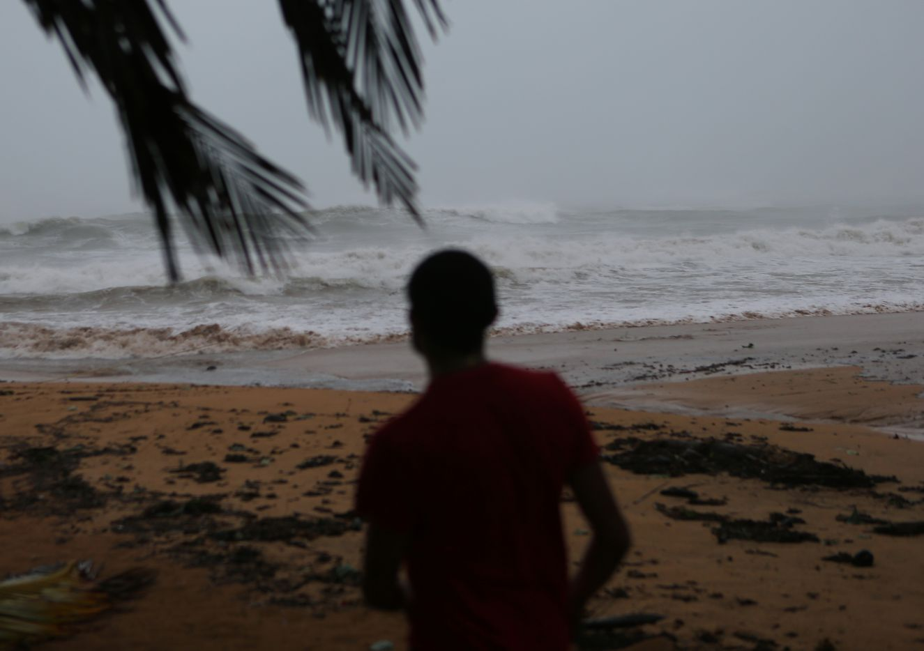 Alexis Ramos looks out to sea at Luquillo Beach prior to the passing of Hurricane Irma on Wednesday in San Juan, Puerto Rico.