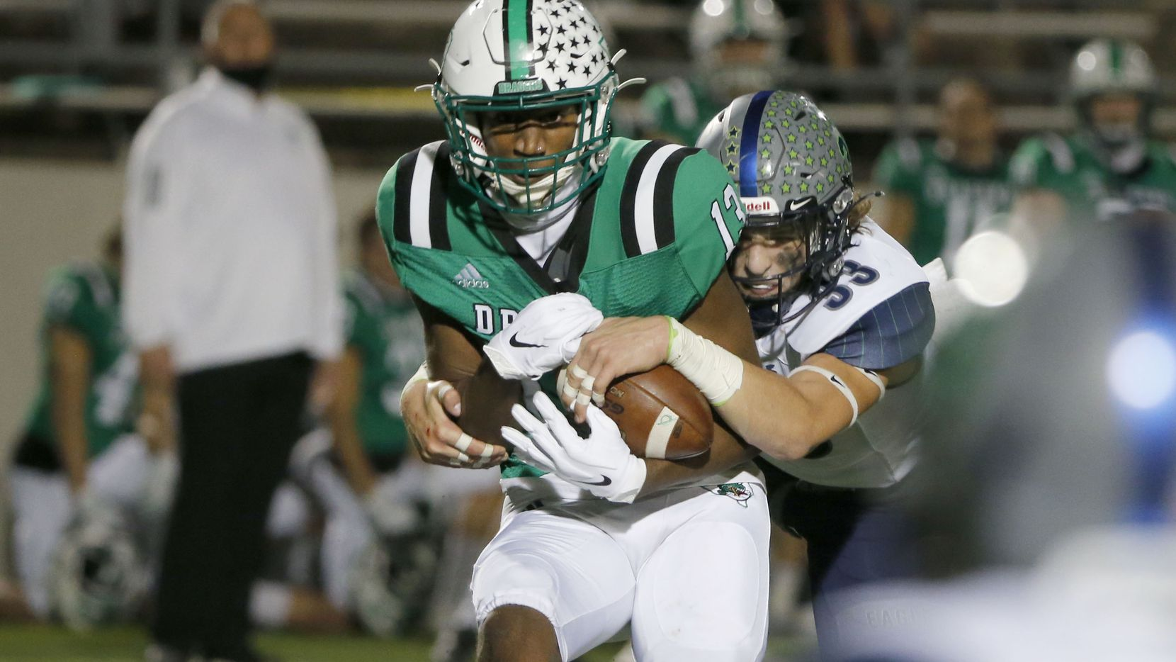 Southlake Carroll's R.J. Maryland (left) makes a reception as he is hit by Northwest Eaton's Ben Roberts during a game on Nov. 20, 2020.