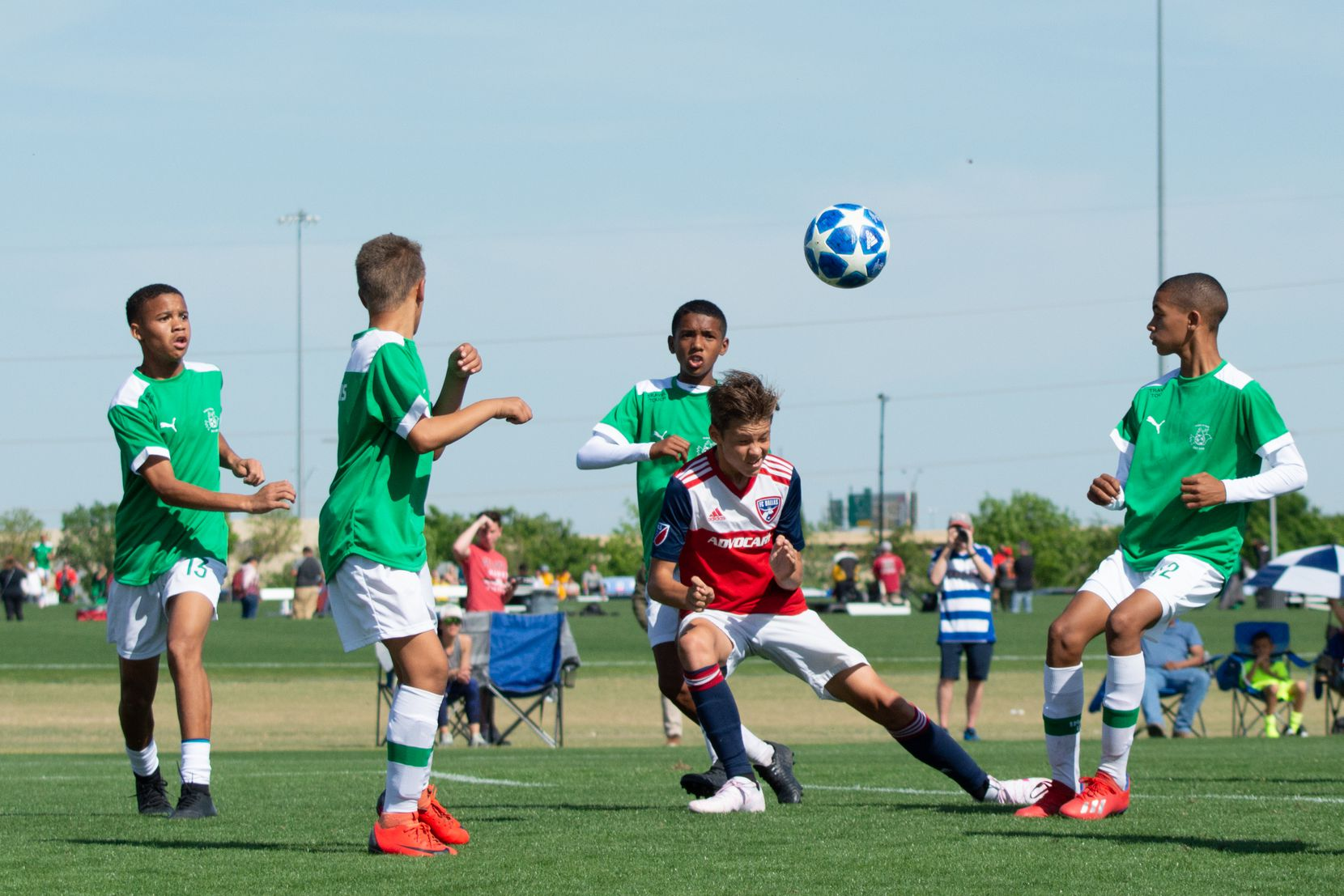 Nighte Pickering heads the ball against Ikapa United in the 2019 Dallas Cup Super 14s.