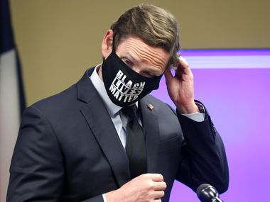 Dallas County Judge Clay Jenkins removes his Black Lives Matters mask to answer a question during his press conference about the use of masks during the resurgence of COVID-19. The press conference was held at the Dallas County EOC, Friday, June 19, 2020.