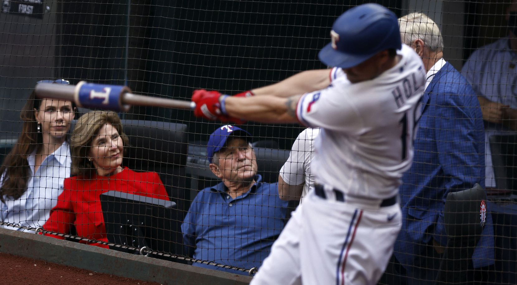 Former President George W. Bush (center) visits with Rangers co-owner Ray Davis as he sits in a field level suite with wife Laura Bush and daughter Barbara Bush during Opening Day at Globe Life Field in Arlington, Monday, April 5, 2021. Biggio was at the game to see his son, Toronto Blue Jays Cavan Biggio. The Texas Rangers were facing the Toronto Blue Jays in their home opener. (Tom Fox/The Dallas Morning News)