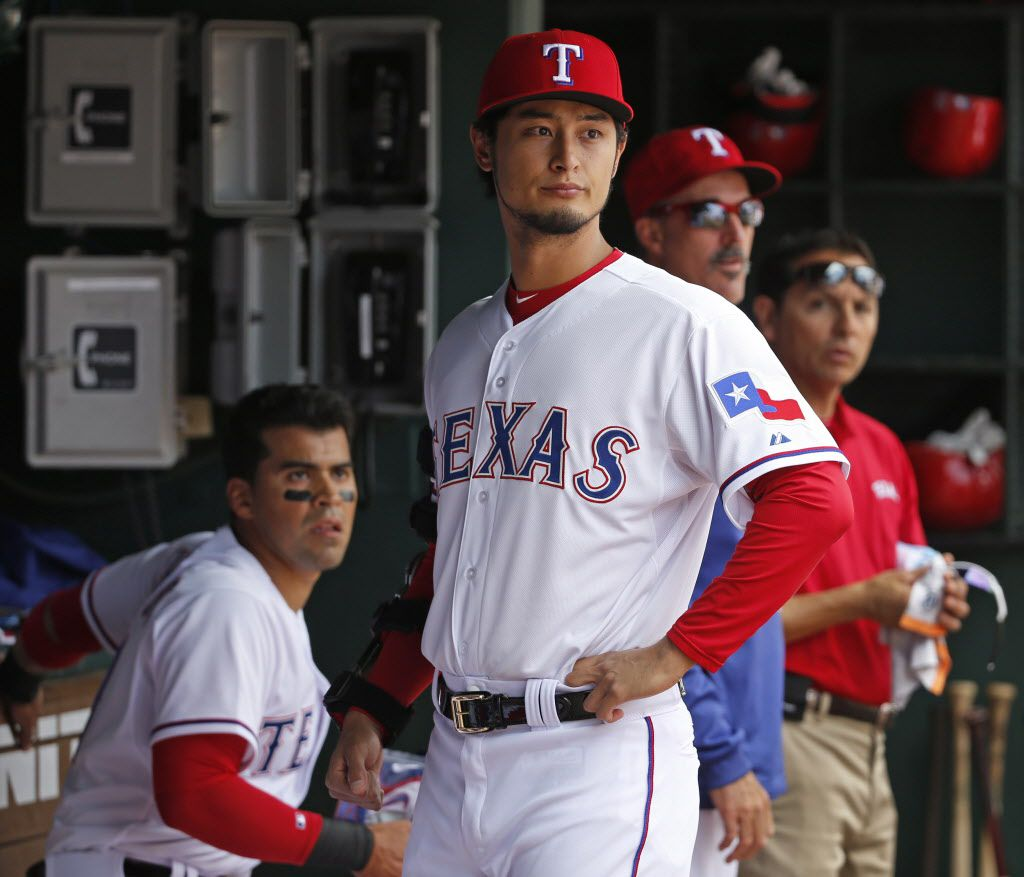 Texas Rangers starting pitcher Yu Darvish (11) is pictured in the dugout during the Houston Astros vs. Texas Rangers Major League Baseball home opener on Friday, April 10, 2015. (Louis DeLuca/The Dallas Morning News)