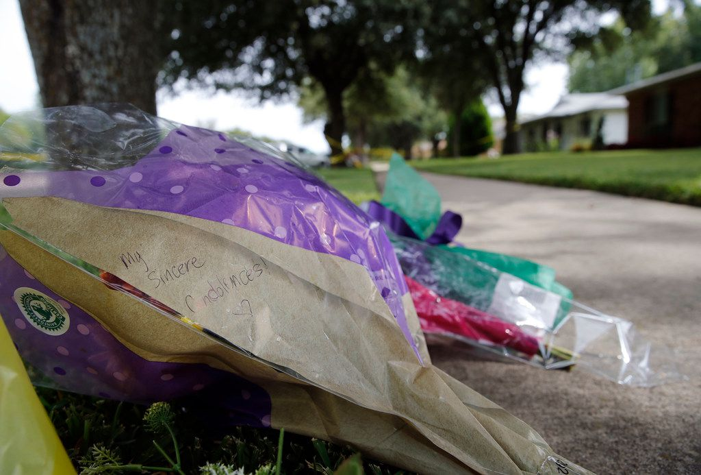 Bouquets of flowers and notes were left near the scene of a shooting on West Spring Creek Parkway in Plano that killed eight people.