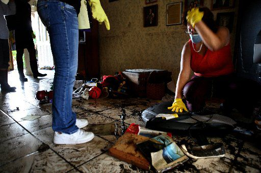 Diane Mitchell went through what was left of her family's belongings after Hurricane Ike hit Galveston in 2008.
