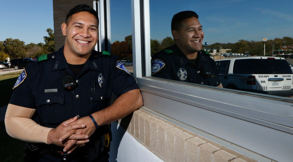 Euless Police officer Eric Fieilo poses for a portrait at Euless High School on Monday, November 21, 2016. The sleeve on his right hand covers a tattoo honoring his Tongan heritage while he is at work. (David Woo/The Dallas Morning News)