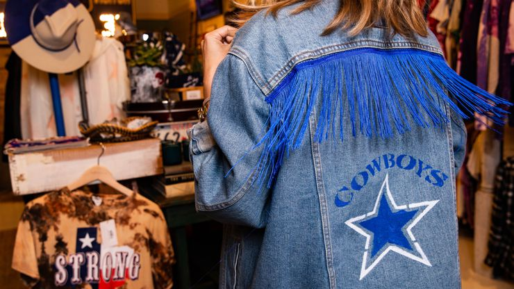 Game Day Style founder Brittany Cobb models a jacket for a photo at her shop across from The Star in Frisco.