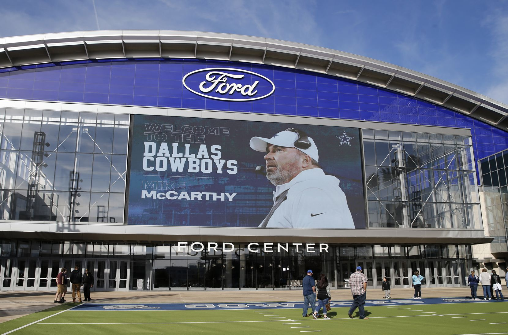 Dallas Cowboys new head coach Mike McCarthy image is displayed on the video board outside the Ford Center at The Star in Frisco, on Wednesday, January 8, 2020.