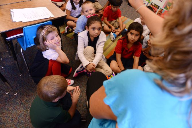 Dual-language teacher Gina Fernandez talks in Spanish to her students during a lesson at Brandenburg Elementary in Irving in this file photo.