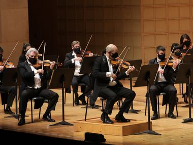 The Dallas Symphony Orchestra, led by concertmaster Alexander Kerr, center, performs at the Meyerson Symphony Center on Jan. 8.