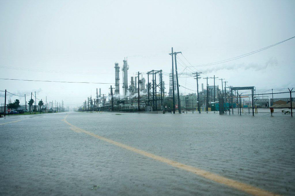 A view of the Marathon Texas City Refinery as it looked Saturday as rain from Hurricane Harvey flooded a road in Texas City. (Brendan Smialowski/Agence France-Presse)
