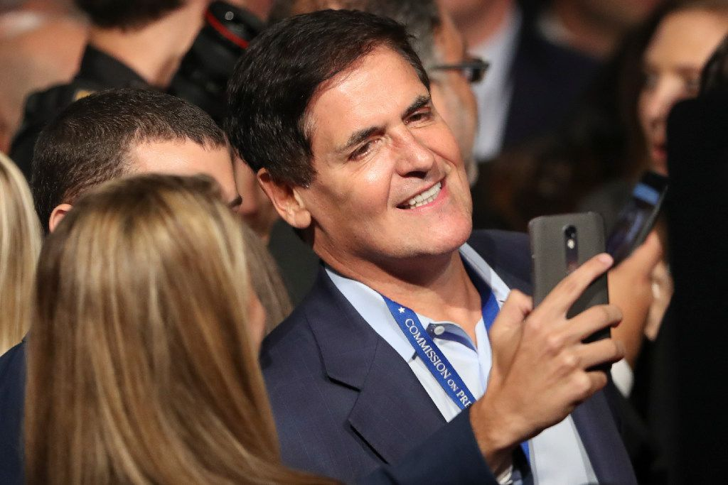 Mavericks owner Mark Cuban poses for a selfie before the presidential debate between Republican presidential nominee Donald Trump and Democratic presidential nominee Hillary Clinton last week. Cuban said Trump's deception about his taxes is worse than anything he did regarding the tax laws. (Joe Raedle/Pool via AP)