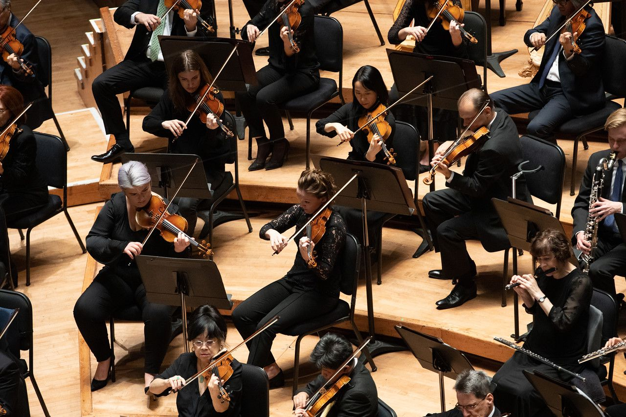 The string section of the Dallas Symphony Orchestra.