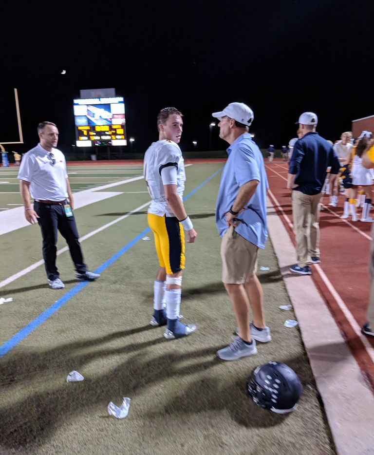 Arkansas coach Chad Morris (right) and his son, Highland Park quarterback Chandler Morris, are pictured during the Highland Park-Frisco Lone Star game on Thursday, Sept. 13, 2018, at Frisco's Memorial Stadium.