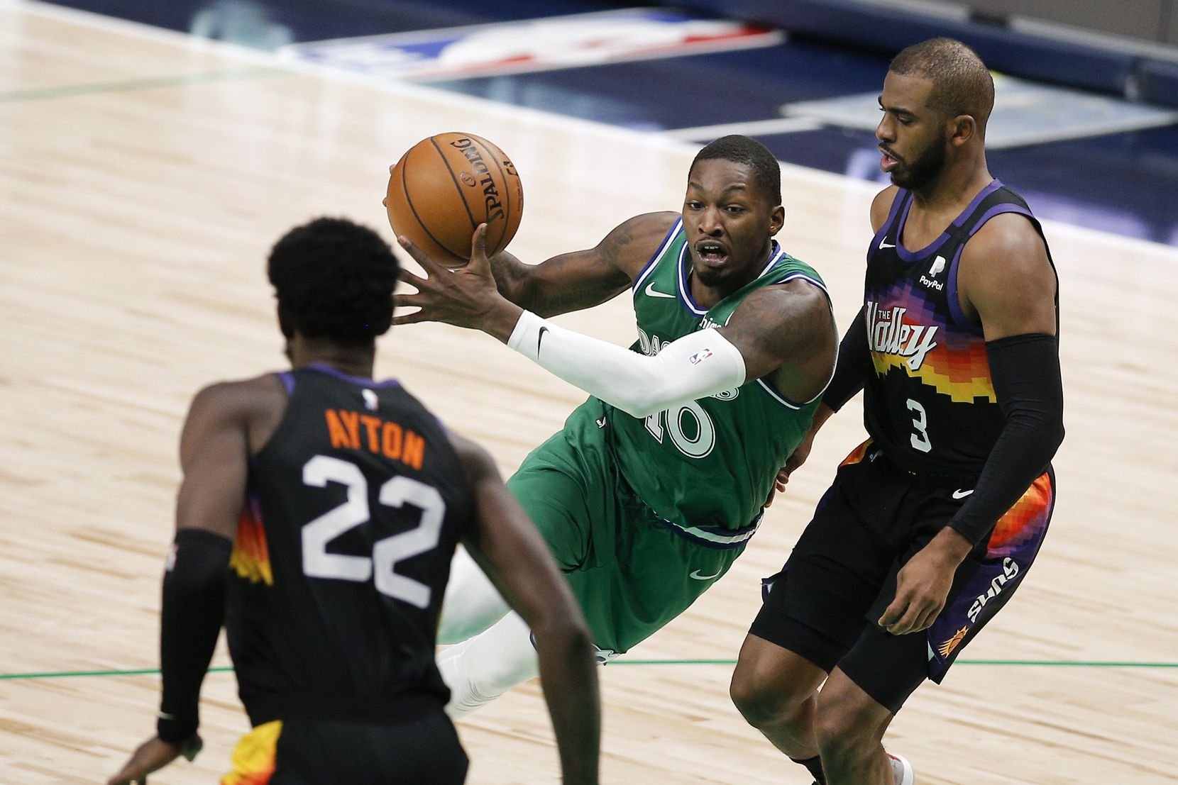 Dallas Mavericks forward Dorian Finney-Smith (10) battles Phoenix Suns forward Deandre Ayton (22) and guard Chris Paul (3) for space during the second half of an NBA basketball game in Dallas, Saturday, January 30, 2021. (Brandon Wade/Special Contributor)