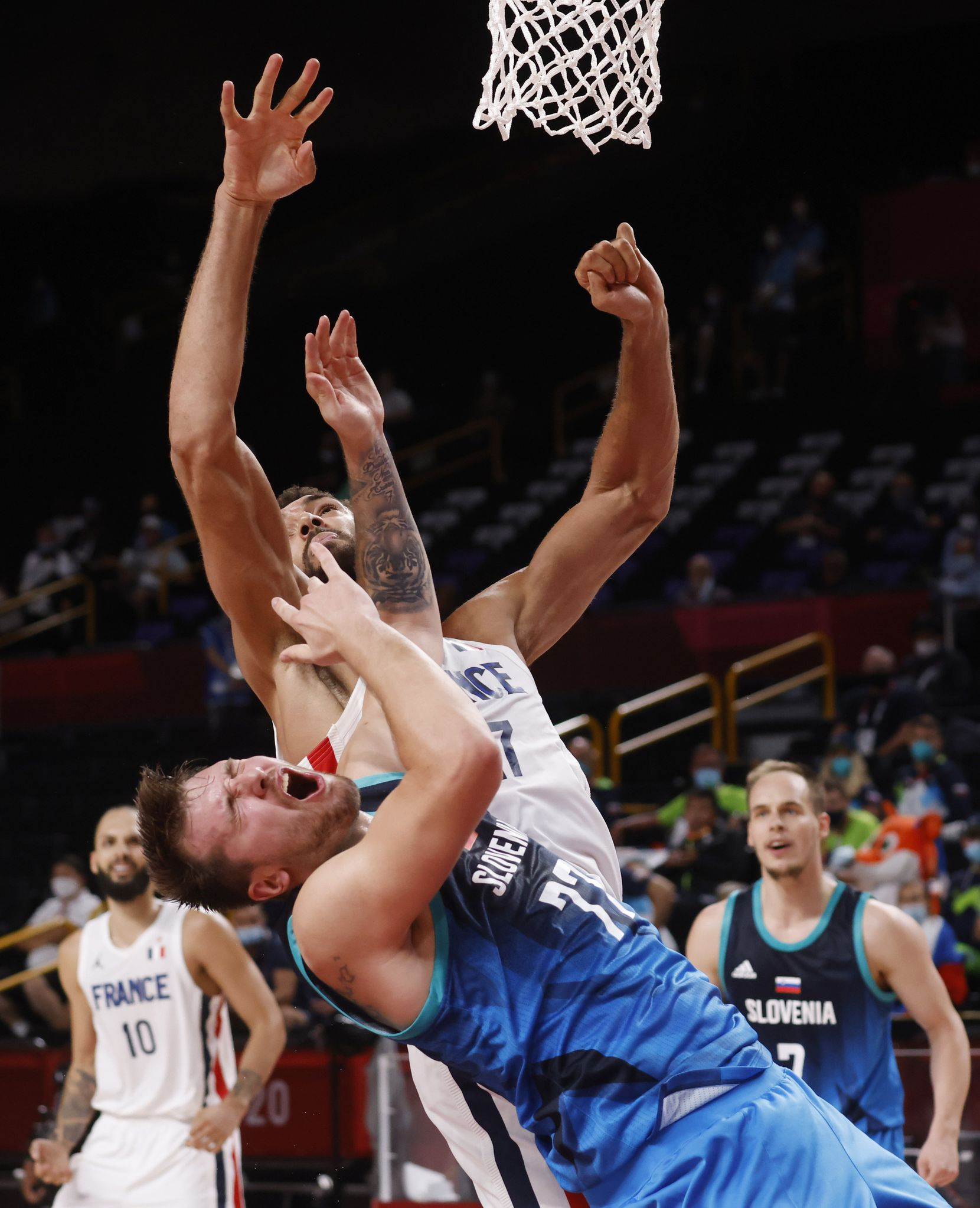 Slovenia's Luka Doncic (77) is hit in the face by France's Rudy Gobert (27) during the second half of a men's basketball semifinal at the postponed 2020 Tokyo Olympics at Saitama Super Arena, on Thursday, August 5, 2021, in Saitama, Japan. France defeated Slovenia 90-89. Slovenia will play in the bronze medal game. (Vernon Bryant/The Dallas Morning News)