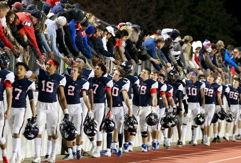 Allen team members slap hands with fans at the end of their 52-40 win over Rockwall in the Class 6A Division I Region II area-round football playoff game at Williams Stadium in Garland on Friday, November 23, 2018. (John F. Rhodes / Special Contributor)