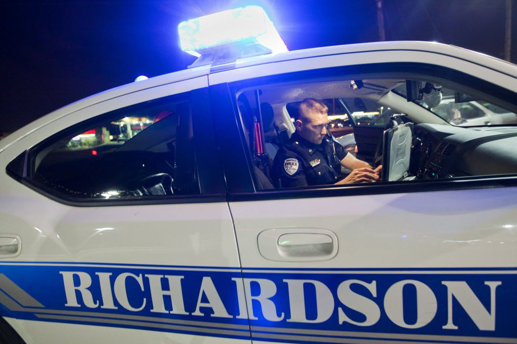 A suspected intoxicated driver crashed into a Richardson police patrol vehicle Wednesday morning while two officers were investigating another accident,