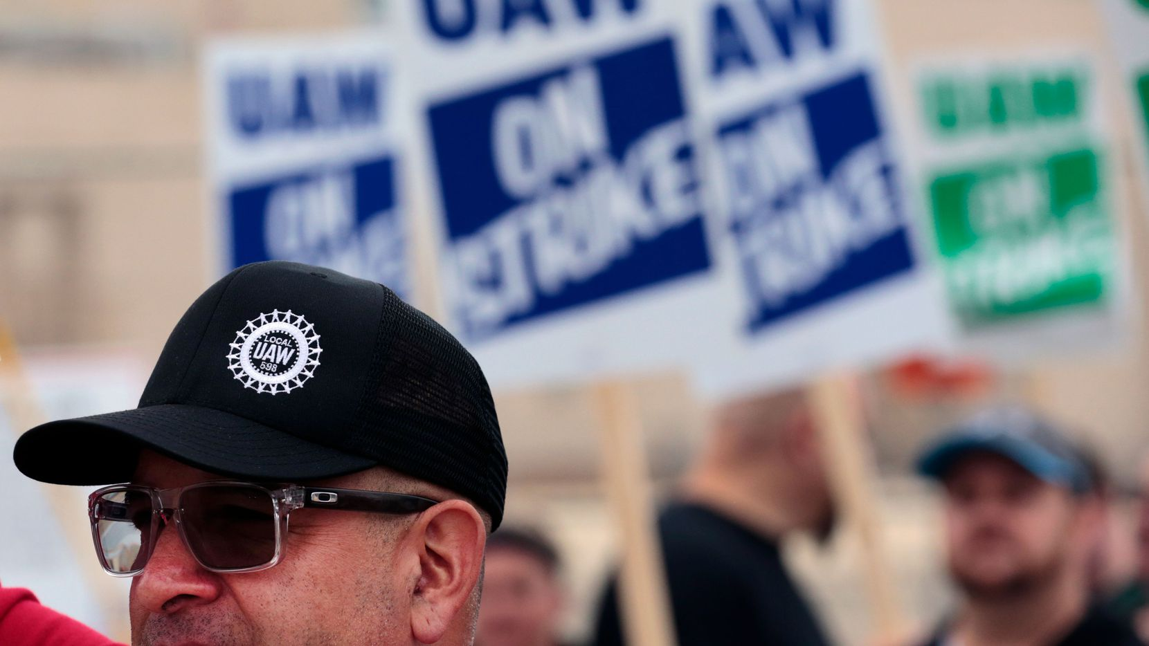 David Garcia, a United Auto Workers member, pickets outside a General Motors Co. assembly plant in Flint, Michigan.