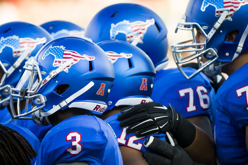 SMU players wearing special patriotic-themed helmets during an NCAA football game against North Texas at Ford Stadium on Saturday, Sept. 12, 2015, in Dallas. (Smiley N. Pool/The Dallas Morning News)