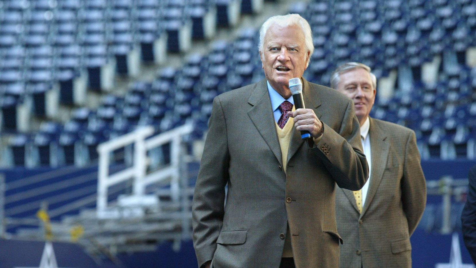 Rev. Billy Graham talks Oct. 2002 about his revival being held at Texas Stadium Thursday through Sunday. Behind him is Boone Powell, co-chairman of the Dallas Billy Graham Mission.