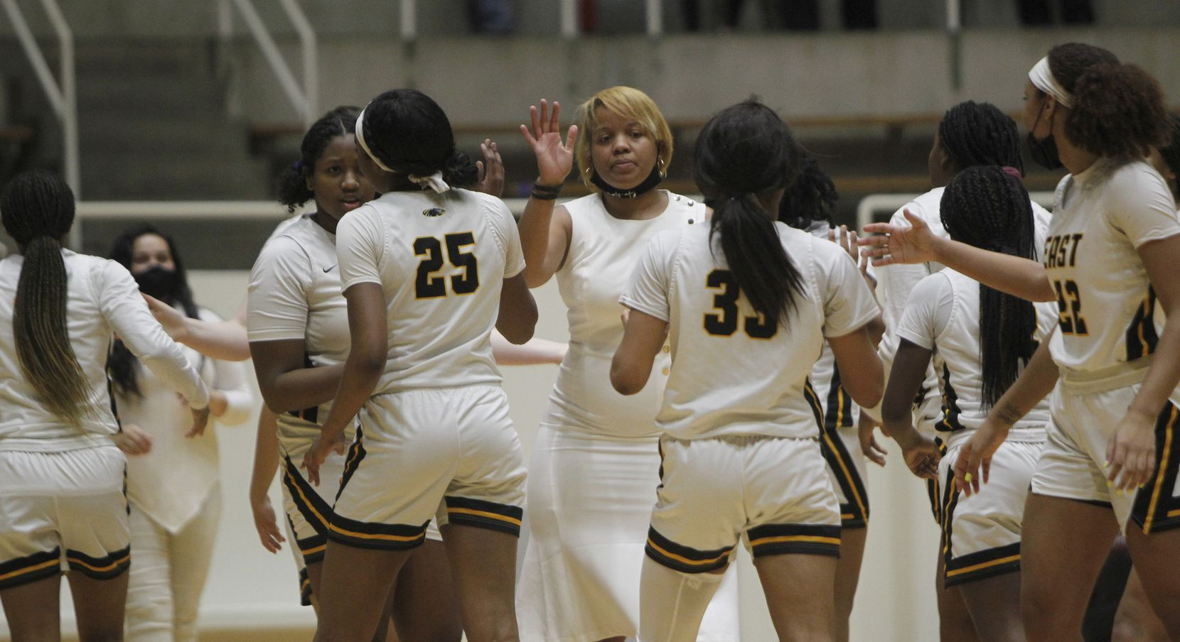Plano East head coach Jessica Linson, center, welcomes her players to the bench area during a first half timeout in their game against Southlake Carroll. The two teams played their Class 6A regional semifinal girls playoff basketball game at Loos Field House in Addison on February 27, 2021. (Steve Hamm/ Special Contributor)