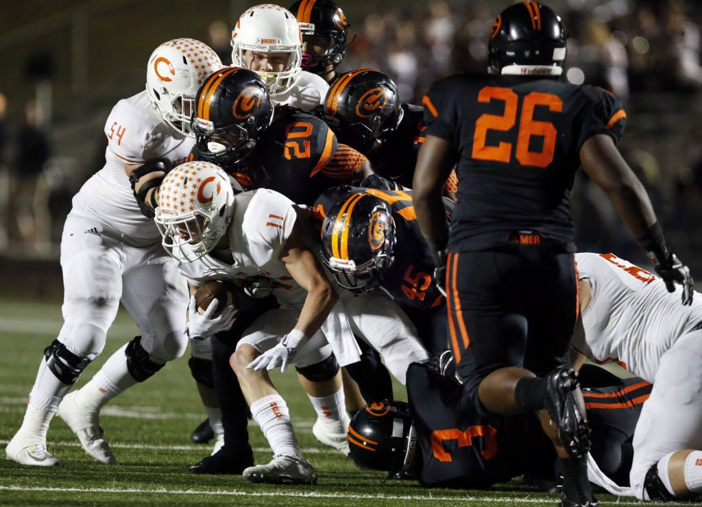 (TXHSFB) Celina Trace Young (11) is gang tackled by a group of Gilmer High defenders, including Cambron Granville (20), Jeremy Kelly (45) and Devin Smith (3) during a high school football playoff game on Friday, December 11, 2014. (John F. Rhodes / Special Contributor)