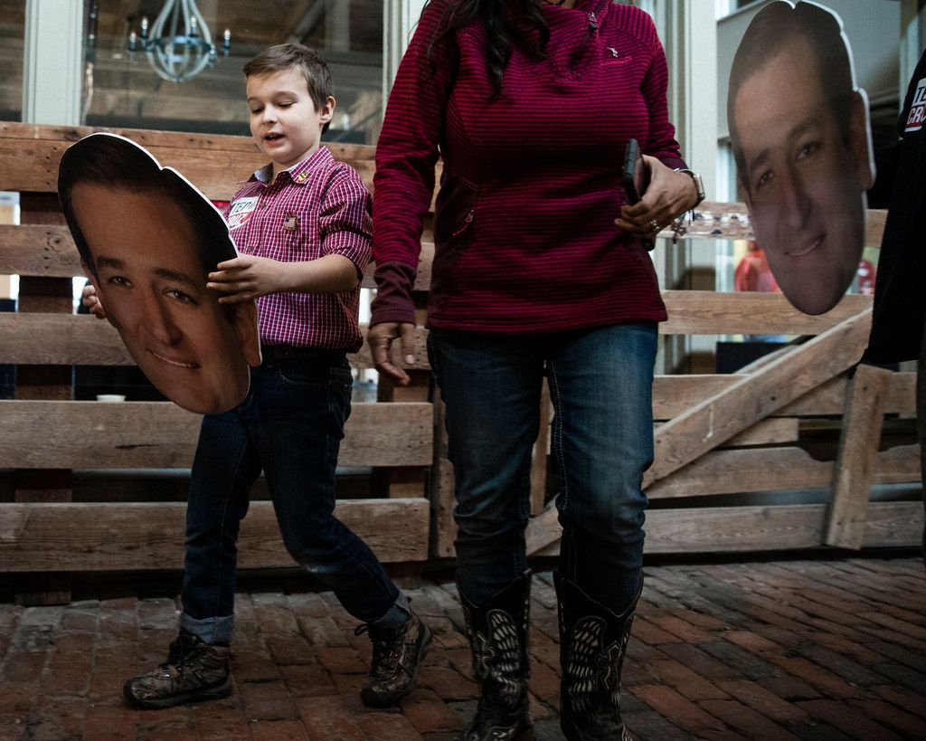Ian Williamson 9, of Fort Worth, carries a cutout picture of Senator Ted Cruz's head as he arrives for Cruz's campaign rally at The Fort Worth Herd on Friday, October 19, 2018. (Shaban Athuman/The Dallas Morning News)