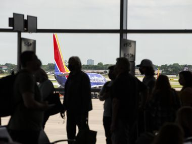 Passengers board a flight to New Orleans at Dallas Love Field in Dallas on May 19.