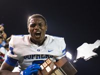 Grand Prairie senior Savion Red (0) exclaims while holding the trophy after the conclusion of Grand PrairieÕs game against South Grand Prairie at the Gopher-Warrior Bowl in Grand Prairie, Texas on Friday, October 8, 2021. Grand Prairie won the game over South Grand Prairie by a final of 34-33. (Emil Lippe/Special Contributor)