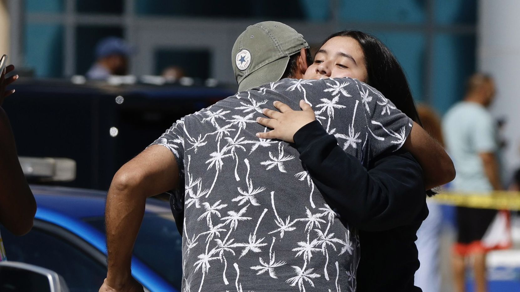 A Timberview High School student gets a hug outside of the Mansfield ISD Center for The Performing Arts on Wednesday, October 6, 2021 in Mansfield, TX.Four people were injured in a shooting at Timberview High School in Arlington on Wednesday morning, and authorities said the suspect remained at large.  (Elias Valverde II/The Dallas Morning News)