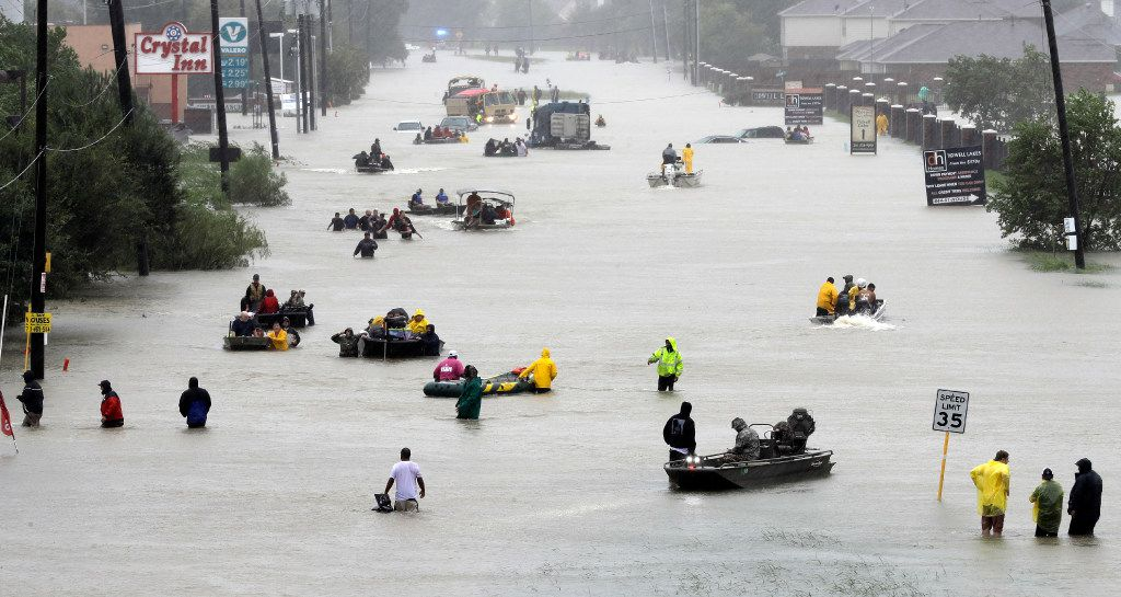 Rescue boats fill a flooded Houston street as victims are evacuated during Tropical Storm Harvey on Aug. 28, 2017.