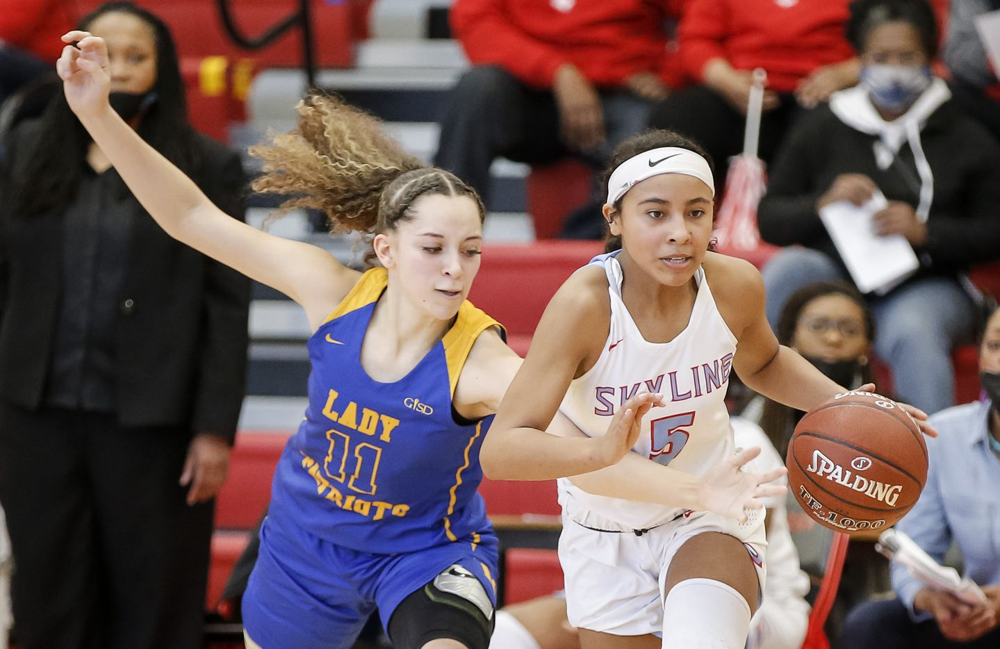 Skyline freshman Lily Brown (5) battles Lakeview Centennial Alexis Gie (11) for space during a girls basketball first-round playoff game at Hillcrest High School in Dallas, Saturday, February 13, 2021. Skyline won 49-42. (Brandon Wade/Special Contributor)