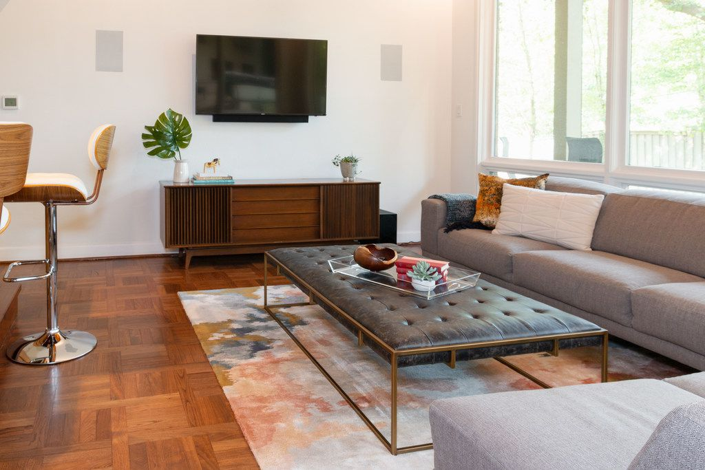 Designer Tara Lenney follows this rule when helping clients select consoles for under a television: The TV should not take up more than two-thirds the width of the console.