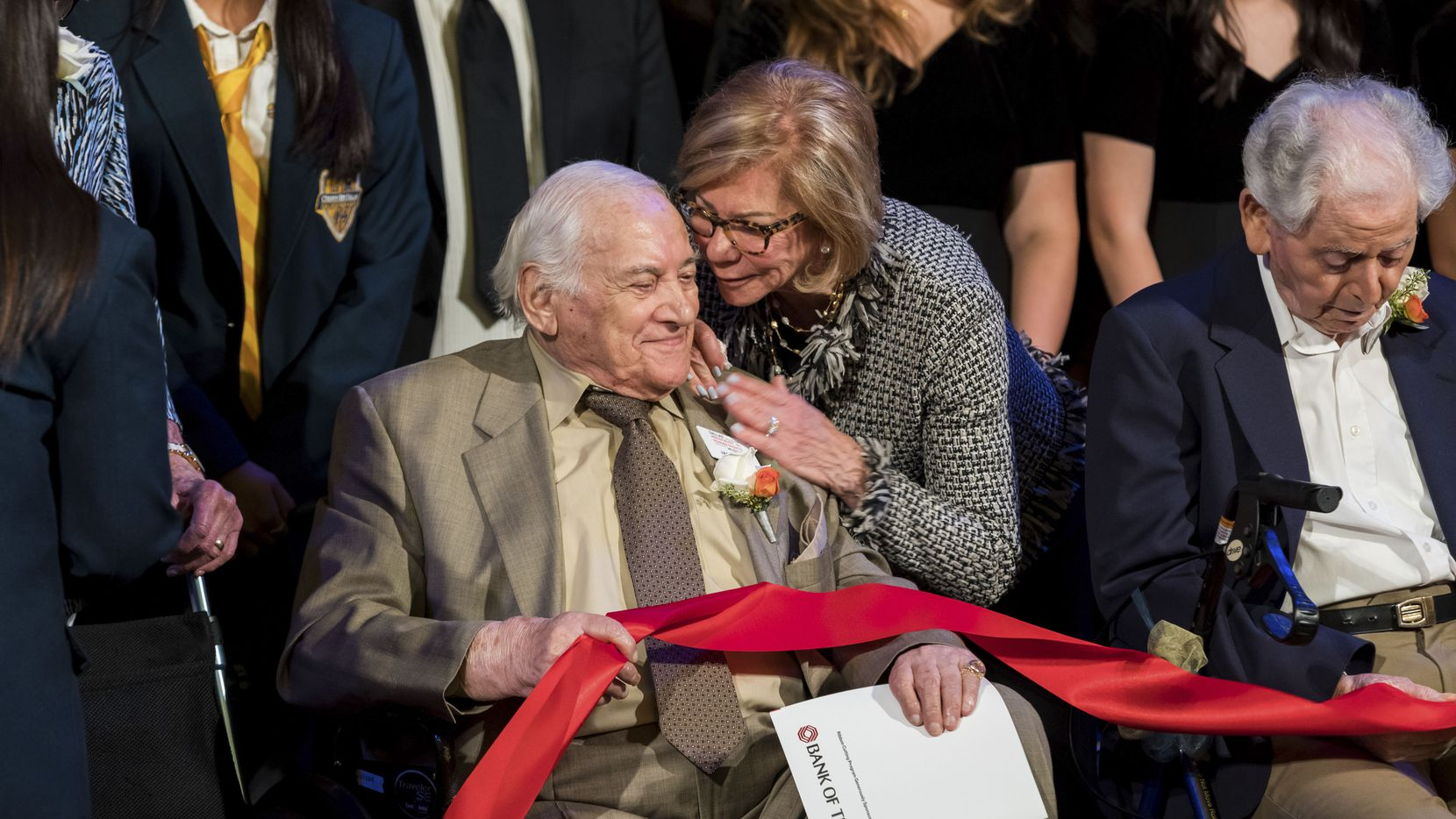 Holocaust survivor Jack Repp is embraced by Florence Shapiro during a ribbon cutting event the new Dallas Holocaust and Human Rights Museum on Nov. 17, 2019. Texas Governor Greg Abbott and other dignitaries joined, staff and Holocaust survivors onstage to cut the red ribbon for the new Dallas Holocaust and Human Rights Museum opening in downtown Dallas, Tuesday, September 17, 2019.