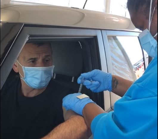 DeSoto Police Chief Joe Costa gets a COVID-19 vaccine as part of an effort to encourage members of the public to get vaccinated.