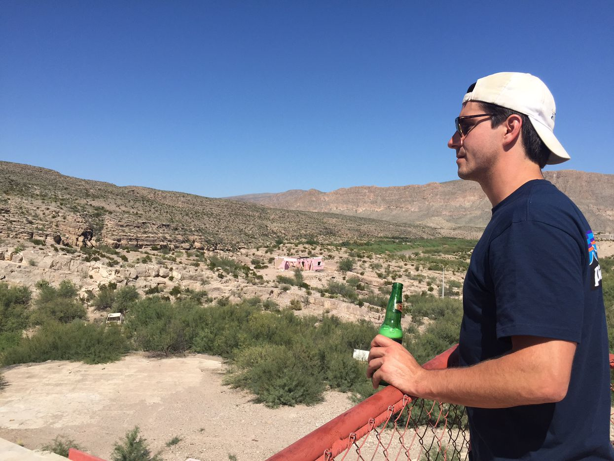 Charles Schaefer, a hiker from San Antonio who went camping in Big Bend National Park with his friends, enjoys a beer and the view in Boquillas, Mexico on the final day of his trip.