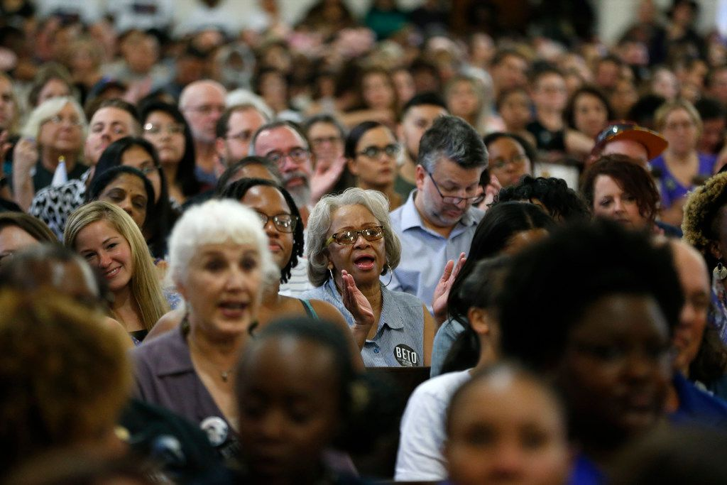 Audience members clap as Beto O'Rourke speaks to the crowd during the South Dallas with Beto! event at Good Street Baptist Church in Dallas on Sept. 14, 2018.  (Nathan Hunsinger/The Dallas Morning News)