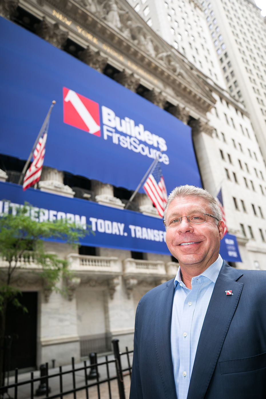 Builders FirstSource CEO Dave Flitman outside the New York Stock Exchange.