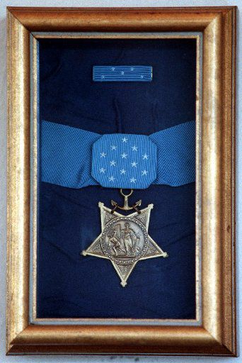 The Medal of Honor awarded to Jack Lummus, a former Ennis High. Baylor University and New York Giants football player who died in combat on Iwo Jima in World War II, hangs in the Ennis Railroad Museum.