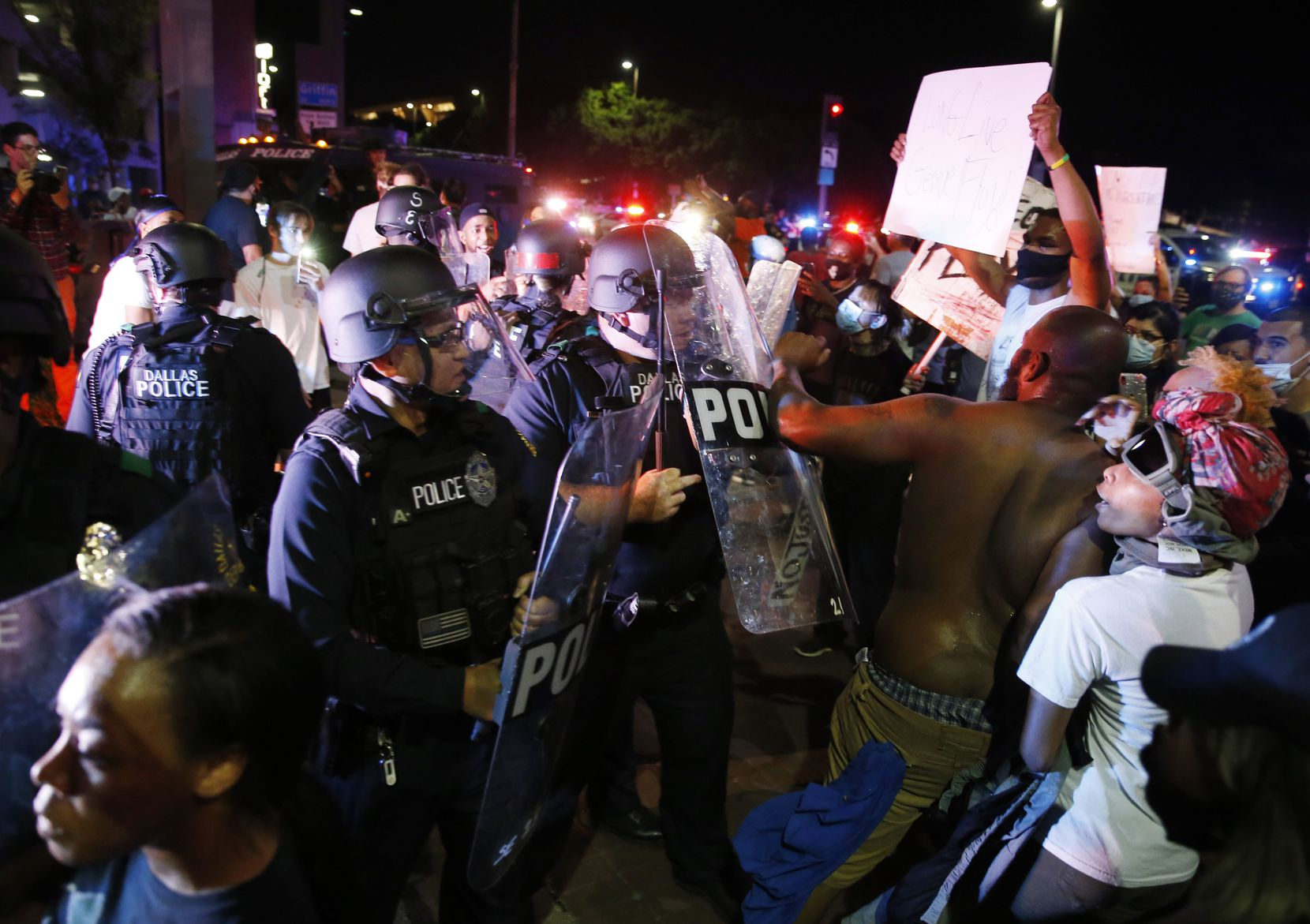 Dallas police interact with  protesters during a rally against police brutality in downtown Dallas, on Friday, May 29, 2020. George Floyd died in police custody in Minneapolis on May 25.