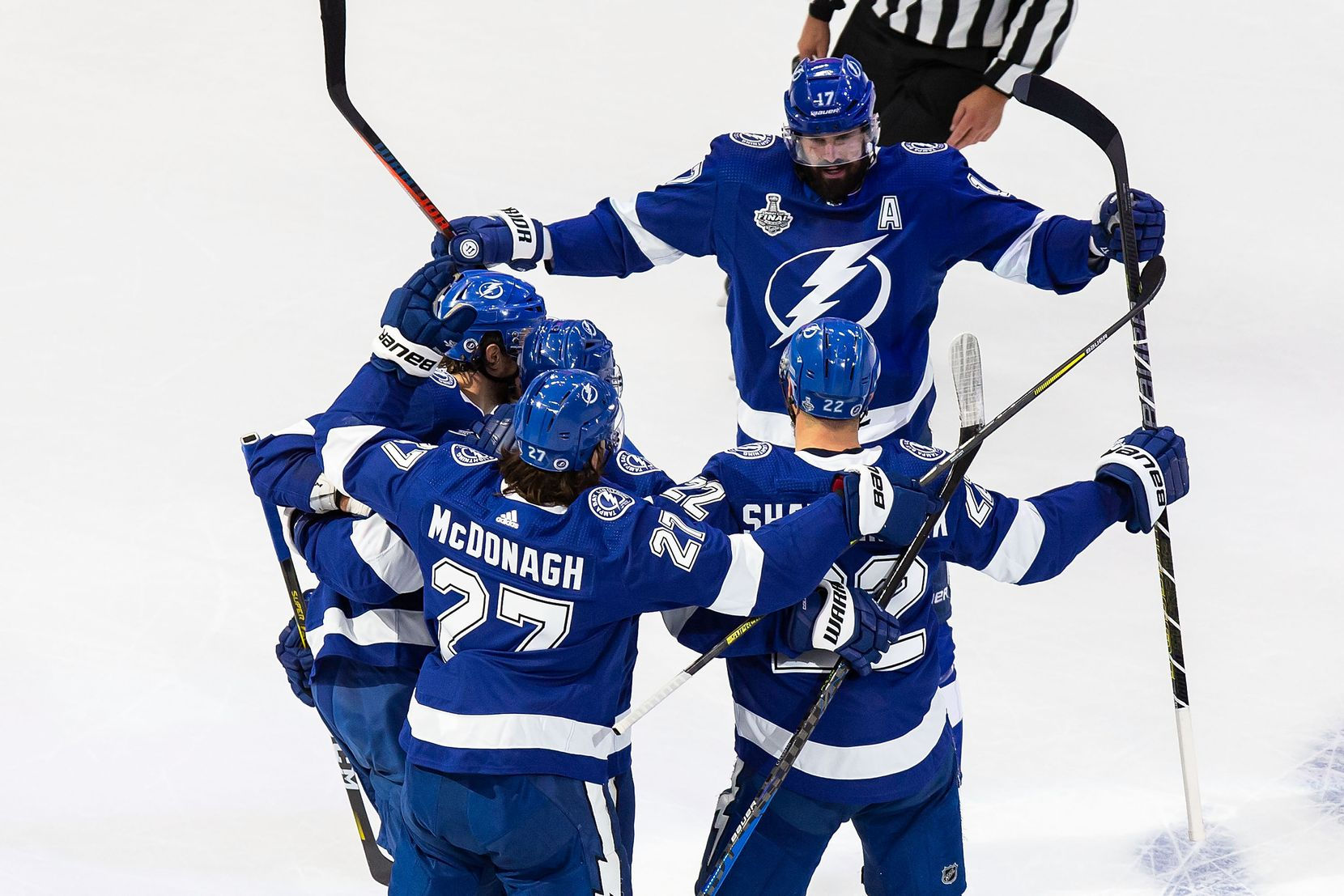 Alex Killorn (17), Ryan McDonagh (27) and Kevin Shattenkirk (22) of the Tampa Bay Lightning celebrate Shattenkirk's goal against the Dallas Stars during Game Two of the Stanley Cup Final at Rogers Place in Edmonton, Alberta, Canada on Monday, September 21, 2020. (Codie McLachlan/Special Contributor)