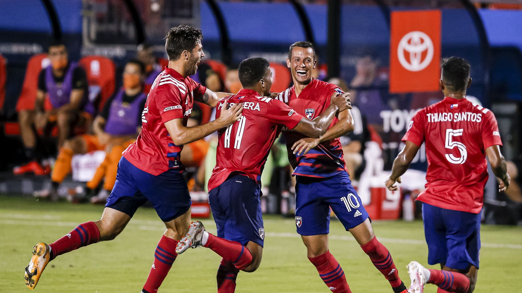 FC Dallas midfielder Ricaurte Velez (10) is congratulated by teammates after scoring a goal during the first half of an MLS soccer match against the Houston Dynamo at Toyota Stadium in Frisco, Saturday, September 12, 2020.