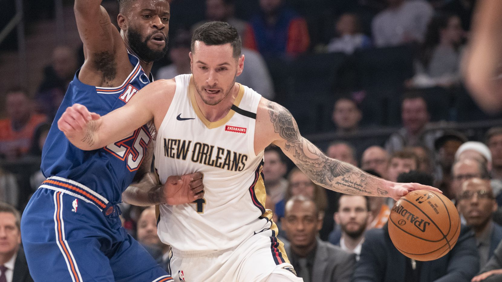 Pelicans guard JJ Redick (4) drives by Knicks guard Reggie Bullock (25) during the first half of a game on Friday, Jan. 10, 2020, at Madison Square Garden in New York.