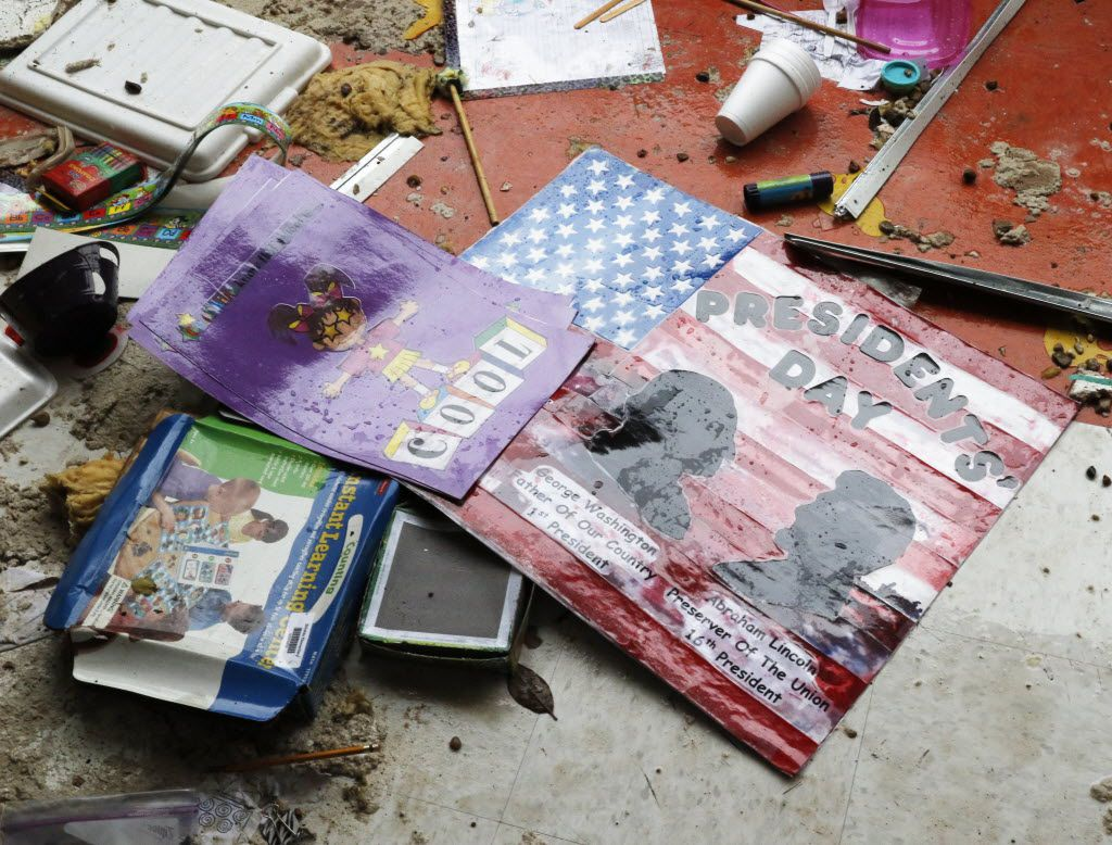 Debris is scattered on the floor of a classroom after a tornado touched down at the Donald T. Shields Elementary School in Glenn Heights in December 2015. (David Woo/The Dallas Morning News)