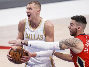 Dallas Mavericks forward Kristaps Porzingis (6) battles New Orleans Pelicans forward Willy Hernangomez (9) for space during an NBA basketball game in Dallas, Friday, February 12, 2021. (Brandon Wade/Special Contributor)