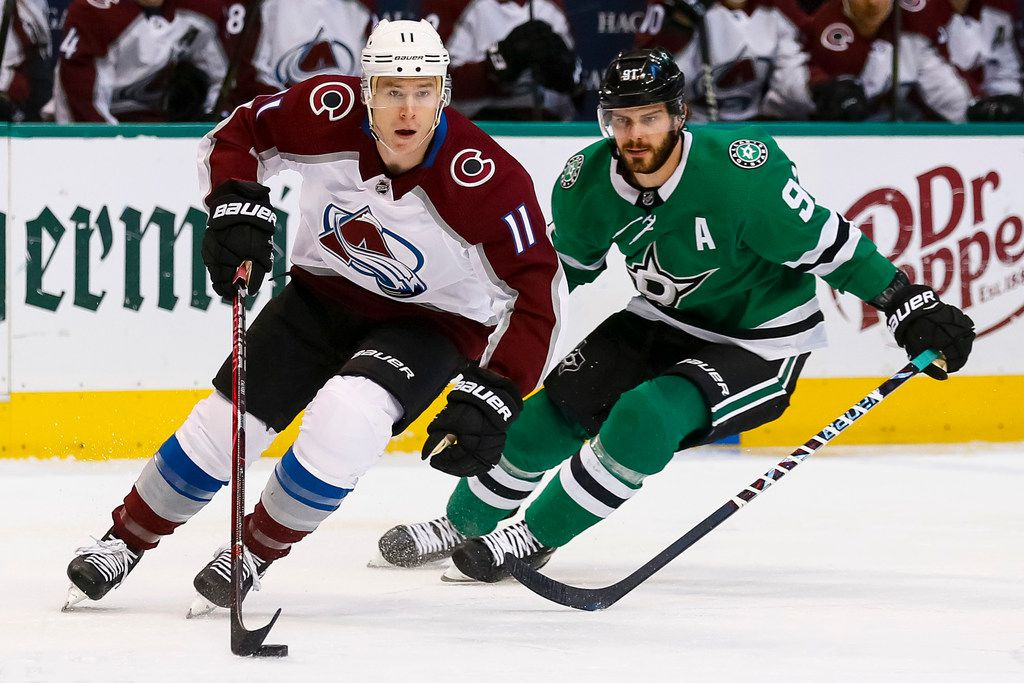 Colorado Avalanche left wing Matt Calvert (11) skates with the puck in front of Dallas Stars center Tyler Seguin (91) during the first period of an NHL hockey game in Dallas, Thursday, March 21, 2019. (AP Photo/Sam Hodde)